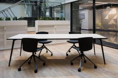 SLAM Chairs and FLY Tables in company offices